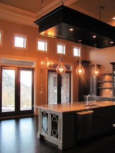 Gorgeous kitchen with high ceilings and suspended ceiling over island