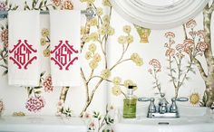 wallpaper: lonny bathroom.  leontine, degournay wallpaper white.  pink.