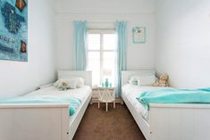 An old weatherboard guesthouse has been transformed into a contemporary Hamptons-style cottage that enjoys a summertime feel year round. Take a tour. Spare Bed, Spare Room, Hamptons House, The Hamptons, California Bungalow, Cottage Renovation, Coastal Cottage, House 2, Beach Cottages