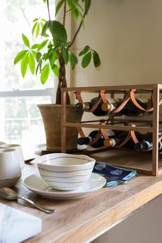 On Cultivating Holiday Rituals - Apartment Therapy celebrates the season with Coil + Drift's Sling Wine Rack and ceramics. Available at www.coilanddrift.com.