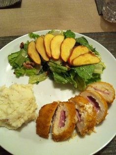 chicken cordon bleu with whole wheat bread crumbs, Gruyere cheese and lite ham. Garlic and herb mashed potatoes and salad with apples and walnuts