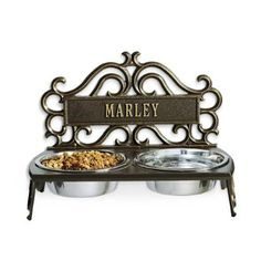 $129.50 18H x 13W x 10D 17 letter monogram. Adorned with elegant scrollwork, this cast aluminum pet feeder can be personalized with your pet name or single initial.            Crafted from cast aluminum                Elevates the stainless steel bowls off the ground, which aids in your pet proper digestion.                Personalize it with up to 17 letters                Made in USA