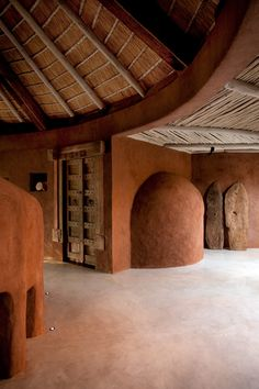 Earthbag Dome, earthen floor, Conical Roof w Papercrete construction
