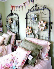 Great Headboard Idea vintage metal fence gates  Not big on the things attached to the gates, but I love the idea!   Cute!