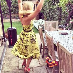 Charlotte Olympia Dellal Mexican Fiesta Birthday Party Outfit by Tara Starlet. Pom-pom trimmed halter bodice top and matching skirt made in a yellow and black mexican papel picado inspired print designed by Poppy Chancellor of Poppy's Papercuts, titled 'Pinup Picado'.