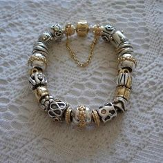 Obsessed with this pandora bracelet!!!! i want one now ....