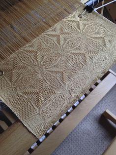 weaving on a hand loom.