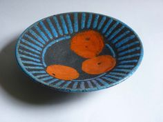 Josse Davis - Raku bowl decorated in Ferro glazes and tin and heavily carbonized.