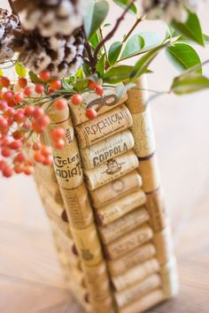 Wine cork vases - the perfect use for all those corks you've been saving! These make great gifts    http://www.designimprovised.com