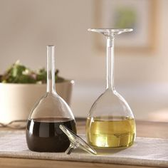 These wine glasses are actually turned upside down and used as vinegar and oil cruets. Nifty.