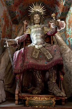 The decorated skeleton of St Deodatus in Rheinau, Switzerland. The dressed up relics were known as the Catacomb Saints and became shrines, reminding believers of the spiritual treasures of the afterlife. (REX/Paul Koudounaris/BNPS)