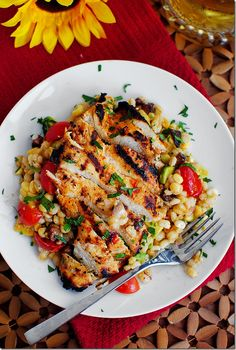 Grilled Marinated Chicken with Barley Corn Salad:  4 chicken breasts 3/4 cup medium barley 2 cups fresh or frozen-then-thawed corn kernels 1-1/2 cups halved cherry tomatoes 1/2 cup minced red onion 4 slices cooked thick or center cut bacon, chopped 1 avocado, chopped salt & pepper