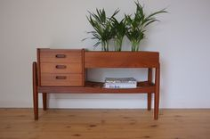 Model #36 teak planter/ entry table designed Arne Wahl Iversen for Vinde Mobelfabrik, Denmark c1960 (W98xD33xH56cm) Three drawers, slatted under-shelf, removable galvanised steel container planted with miniature palm trees
