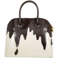 A legendary, leather confection from Moschino, vanilla based with chocolate dripping pattern pouring atop, perfected with goldtone heart charms. Description from thebagforum.com. I searched for this on bing.com/images