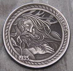 A wonderfully executed nickel carved by Stephen D. Cox