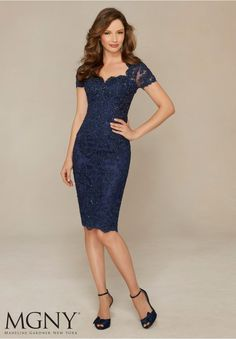 Evening Gowns and Mother of the Bride Dresses by MGNY Beaded Lace Appliqués on Net Colors: Navy, Silver.