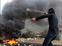 A Palestinian protester slings a stone at Israeli soldiers during a demonstration against the seizure of Palestinian land by Israel in Kfar Qaddum village, West Bank. Born Again Christian, Mad World, Soldiers, Israel, Around The Worlds, Stone, Rock, Stones, Batu