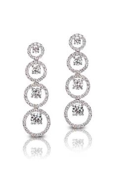 King Jewelers Four Circle Diamond Drop Earrings . These earrings are made of 18 karat white gold and feature four graduation pave diamond hoops. The center of each hoop is set with a single round-cut white diamond. Fine Bridal Jewelry, Fine Jewelry, Diamond Drop Earrings, Diamond Are A Girls Best Friend, Jewellery Display, Jewelry Branding, Round Diamonds, Jewelry Stores, Diamond Engagement Rings