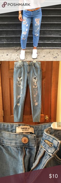 """Boyfriend Jeans Lightly worn light wash ripped boyfriend jeans from Forever21. SIZE 27! These jeans are comfortable and the rips are in the same condition/size they were when I bought them a few months ago. Any questions please ask :) Selling these because they're a tad shorter on me than I prefer (I'm 5'8"""") however they still look cute cuffed like in the photo! Forever 21 Jeans Boyfriend"""