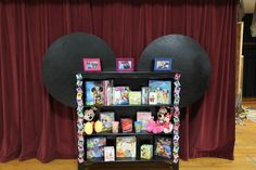 Mickey Mouse Bookshelf--pictures of all the kids (in 1st grade class) wearing mickey ears down the front.