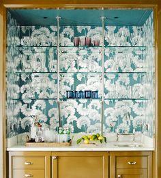 Beautiful graphic wallpaper behind glass open shelving