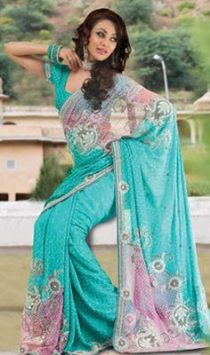 Deep Blue Embroidered Georgette Saree Price: Usa Dollar $447, British UK Pound £262, Euro331, Canada CA$480 , Indian Rs24138.