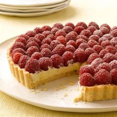 indulgent white chocolate and fresh raspberry tart........ it just sounds sooo... good <3