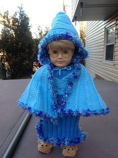 This knitted cape is simply essential for the American Girl Doll intending to go caroling this Christmas Eve! I was inspired by the style of cape often worn in Victorian times.