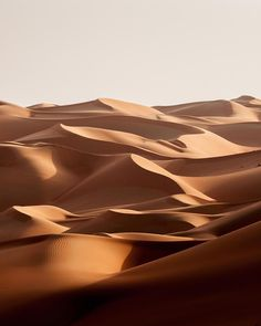 The calming curves of Abu Dhabi's mountainous dunes UAE. The calming curves of Abu Dhabi's mountainous dunes UAE. Abstract Landscape, Landscape Paintings, Landscape Design, Acrylic Paintings, Landscape Photography Tips, Nature Photography, Travel Photography, Desert Dunes, Landscape Edging Stone