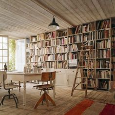 The sun-soaked library in a home remodeled from an old factory in Belgium.