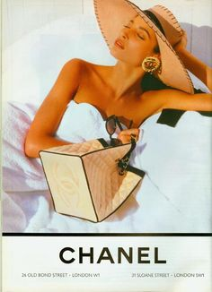 Vintage Chanel Ad. Love the bag.