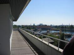 "Enalyzer, HQ, Copenhagen. Office. Terrace view.  Summer Enalyzer HQ  Tower center - Parlament  ""Box"" building center - Royal Opera  Office balcony"