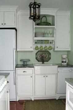 Small Kitchen Space Design Smaller white appliances, a farmhouse sink and cottage-inspired details to give this adorable 575-square-foot beach cottage an equally adorable kitchen.