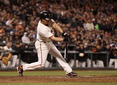 SAN FRANCISCO, CA - APRIL 14: Ryan Theriot #5 of the San Francisco Giants hits a single in the ninth inning against the Pittsburgh Pirates at AT Park on April 14, 2012 in San Francisco, California. (Photo by Ezra Shaw/Getty Images)