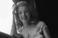 Norma Jeane aboard a train from NYC in June 1949.
