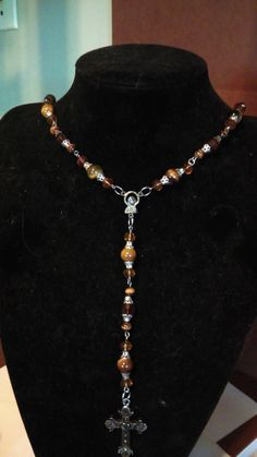 24 Inches round necklace, 29 inches long  cross 3 inches long 2 wide    beads glass-silver bead caps, gold hook ,eye pins  beads- 1 cm or smaller ,cat eyes beads, acrylic beads   Shop this product here: http://spreesy.com/BlueeyesJewelryShop/132   Shop all of our products at http://spreesy.com/BlueeyesJewelryShop      Pinterest selling powered by Spreesy.com