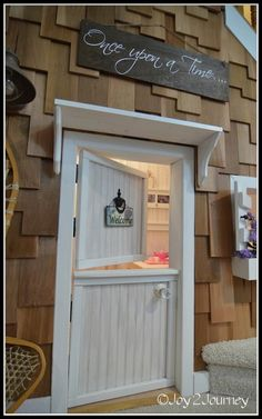 Kid's under the stair playhouse! Love the door