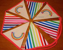 Gorgeous bright rainbow bunting with hand embroidered rainbows/buttons and rainbow striped fabric