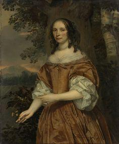 Jan Mijtens | Maria de Witte Françoisdr (b 1616). Wife of Johan van Beaumont, Jan Mijtens, 1661 | Portret van Maria de Witte Francoisdr, echtgenote van Johan van Beaumont. Staand, ten halven lijve, voor bomen en een landschap. Een bloem in de rechterhand. Pendant van SK-A-746.