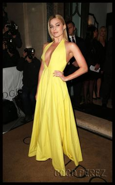 Beautiful yellow dress. Plunging neckline. Tan. Long straight hair. Love yellows and creamsicle tones