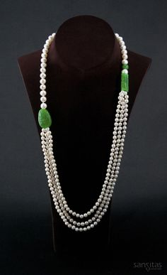 Nereus White I - An illustrious multi-layered necklace that harmonizes the elements of the sea and earth. Crafted from pristine white round and potato-shaped pearls. Playfully contrasted with hand carved and polished green jadeite ornaments.