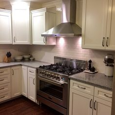 My white classic kitchen remodel with my new Italian Verona Range that cooks like a dream.