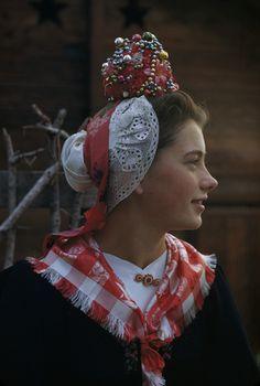 A woman models a traditional bride's headdress from Evolene. Location: Evolene, Switzerland. Photographer: WILLARD CULVER