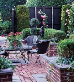 Brick patio with wrought iron table