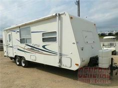 Used 2003 Coachmen RV Captiva 249QRB  This travel trailer has a sofa bed and matching booth dinette, double sinks in the kitchen, refrigrator/freezer, 3 burner stove and oven, plus a microwave.  The bedroom has storage above on on one side. In the bath area there is a shower,toilet and vanity sink with medicine cabinet and mirror. Outside there is another shower and main awning.