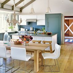 Beach retreat white and blue kitchen from Coastal Living is a nice mix of traditional and modern.