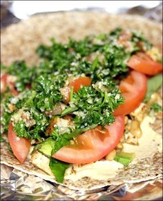 Mediterranean Lunch Wrap - Hummus, Tabouleh, Avocado, Chicken, Tomato, Greens, Basil and Pepper to taste.