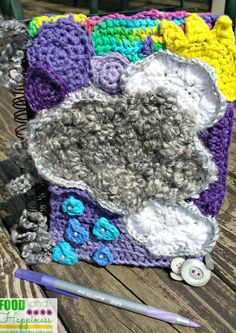 """Silver Linings"" Freeform Crochet Notebook. Yarnart, clouds, sun, rain. Handmade. #FoodandHappiness"