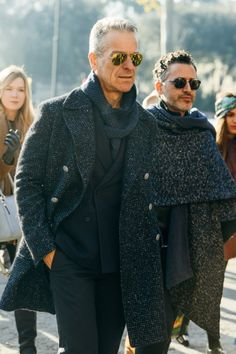 the topcoat. the suit. the shades. the scarf. it's all perfect.