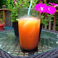Goombay Smash:   Spiced rum, Malibu rum, pineapple juice, orange juice, splash of grenadine.  Perfect for summertime!